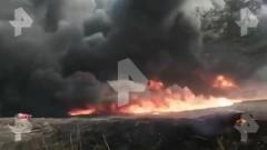 На заводе в Ленобласти загорелись бочки с мазутом